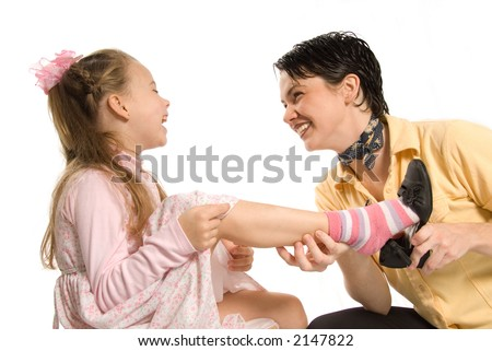 mom and daughter playing dress-up on white background - stock photo