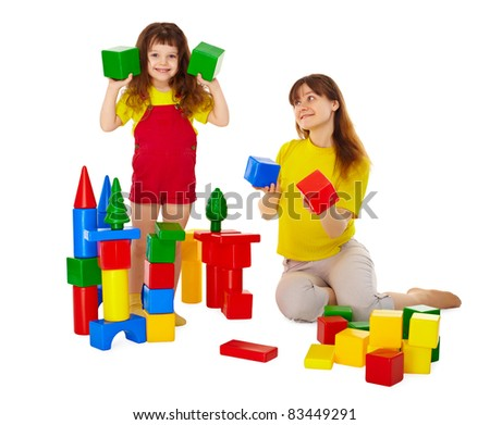 Mom and daughter playing with blocks isolated on white background - stock photo