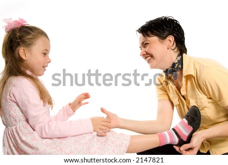 mom and daughter sharing a moment on white - stock photo