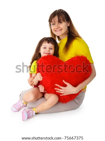 Mom and daughter sit with a toy heart in his hands isolated on white background - stock photo