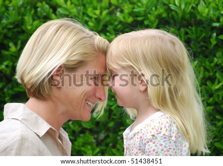 mom and daughter smiling - stock photo
