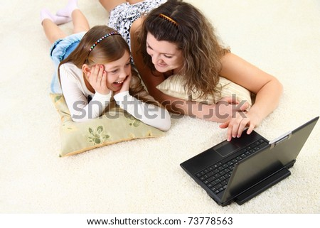 Mom and daughter spend time with laptop