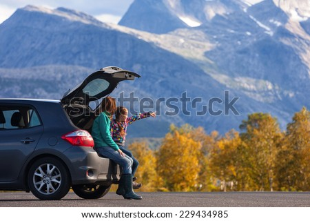 Mom and daughter - tourist girls and mountain views  - stock photo