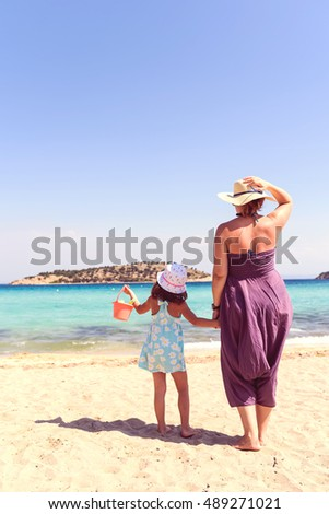 Mom And Girl At Tropical Beach During Summer Vacation
