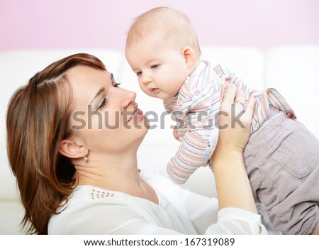 mom and her baby, happy family. - stock photo