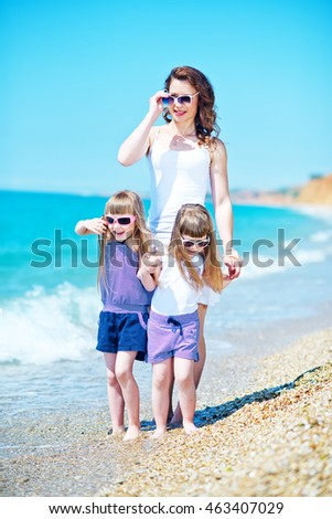 Mom and her children on the beach