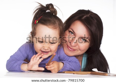 mom and her daughter drawing at table