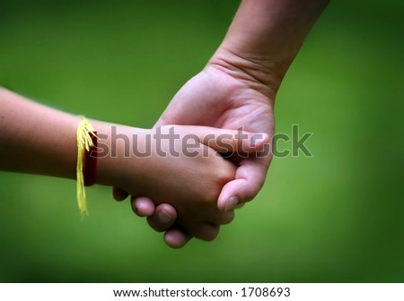 Mom and her young daughter holding hands - stock photo