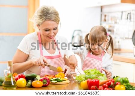 mom and kid girl preparing healthy food - stock photo
