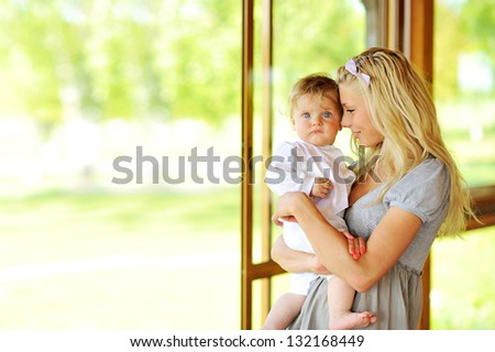 Mom and kid outdoors portrait - stock photo