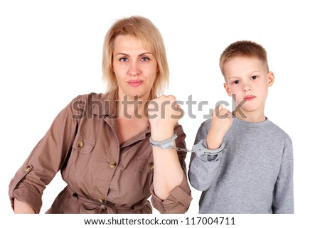 mom and son chained with the handcuffs - stock photo