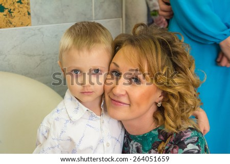 Mom and son having fun and relax in a cafe