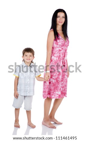 mom and son in full growth. isolated on white background