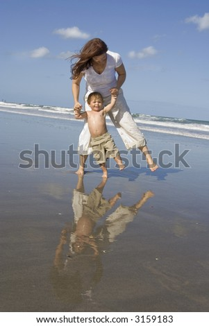 Mom and son on a beach - stock photo