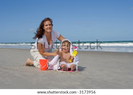 Mom and son on a beach