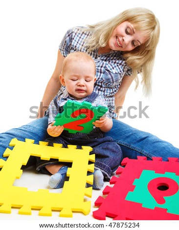 Mom and son playing with colorful number puzzles