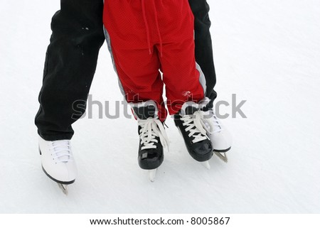 mom and son skating - stock photo