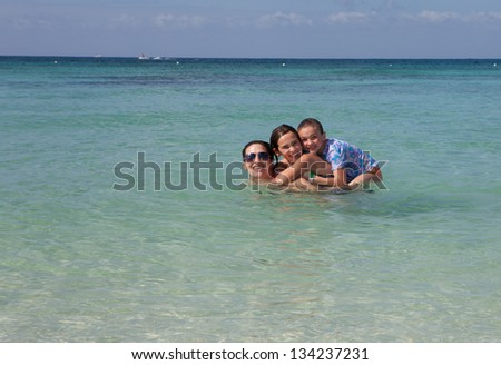 Mom and two daughters in the caribbean - Happy Family - stock photo