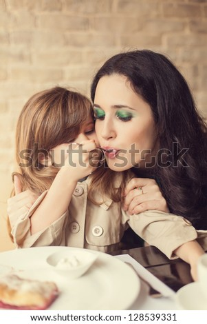 Mom and young daughter eating breakfast