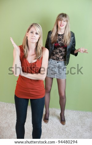 Mom angry with annoyed daughter's provocative clothing - stock photo