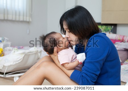 Mom be loving her daughter - stock photo