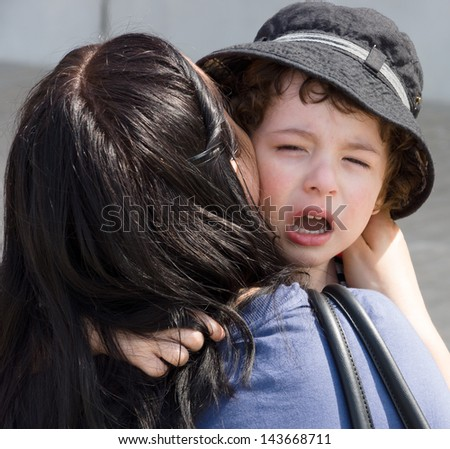 Mom calms weeping children. - stock photo