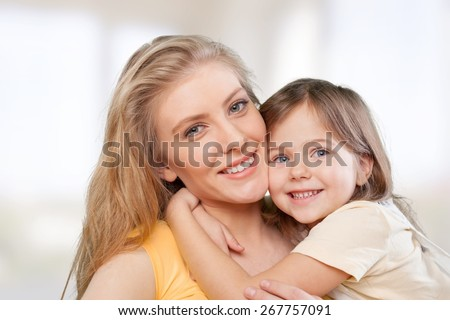 Mom. CLoseup portrait of happy  white mother and young daughter - isolated. Happy family people concept. - stock photo