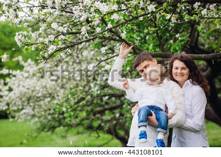 Mom, dad and their little boy - stock photo