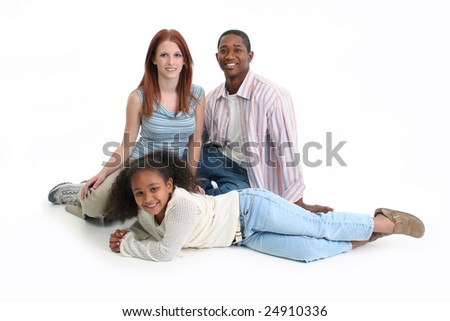 Mom, dad, daughter. Happy interracial family over white background. - stock photo