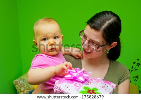Mom giving a present a child