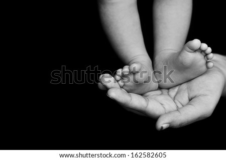 Mom Hand hold the Baby Leg - stock photo