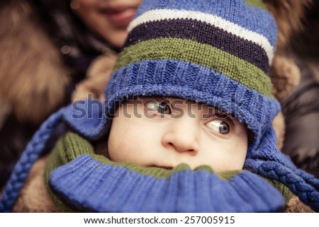 Mom holding her handsome son - Woman and baby outdoors - stock photo