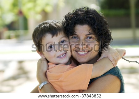 Mom holding her son ( happy familiy )
