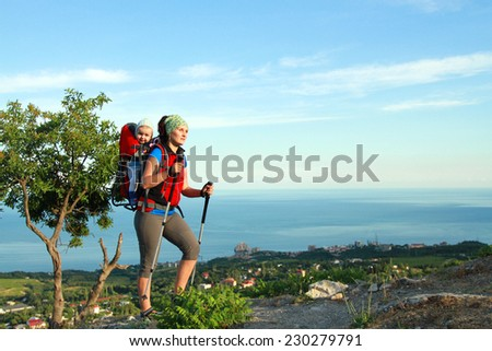 Mom is in the child's backpack. - stock photo