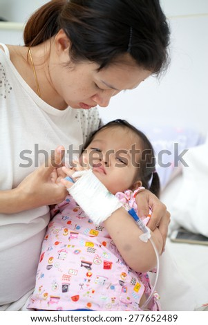 Mom is take care her baby - stock photo