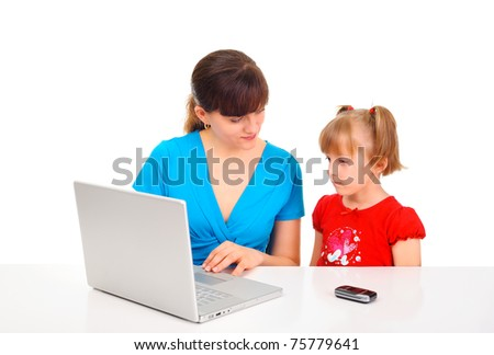 Mom is teaching her daughter how to use computer - stock photo