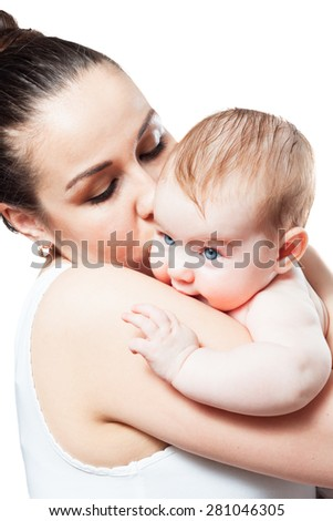 Mom kisses and hugs her child. affection and tenderness - stock photo
