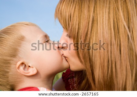 Mom kisses the favourite son.