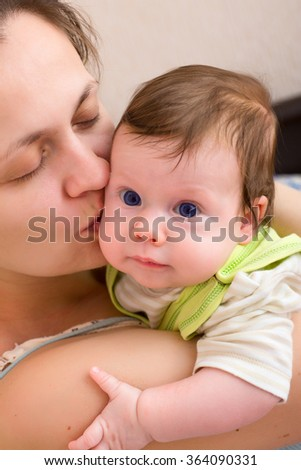 mom kissing baby - stock photo
