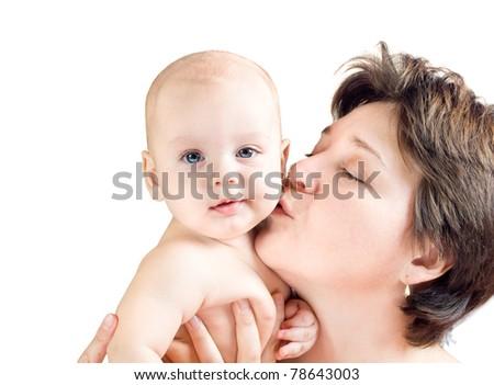 Mom kissing baby's cheek - stock photo
