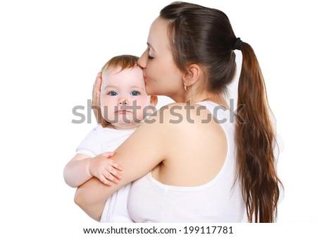 Mom kissing cute baby - stock photo