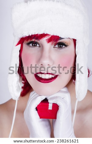Mom noel makeup of beautiful woman with white hat - stock photo