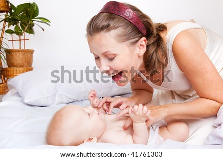 Mom playing with her cute baby - stock photo
