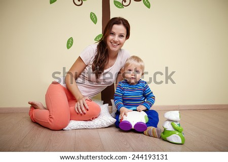 Mom playing with son - stock photo