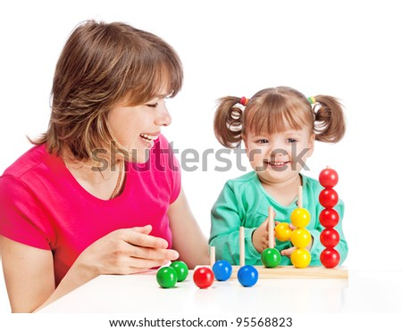 Mom plays with her daughter - stock photo