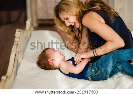 Mom plays with her son. happy family - stock photo