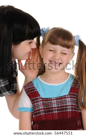 Mom sharing a secret with her daughter - stock photo