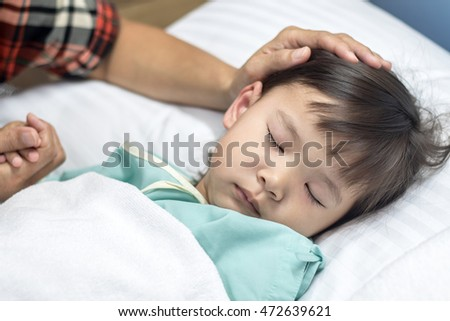 Mom take care child have a fever in the hospital