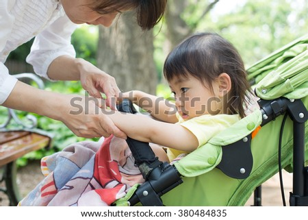 mom takes care of her kid - stock photo