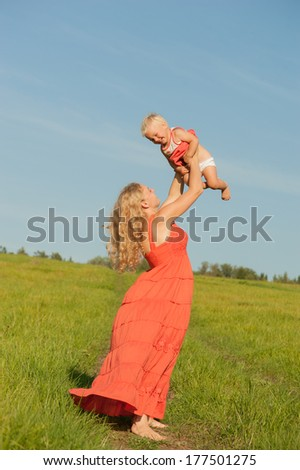 Mom throws up daughter - stock photo
